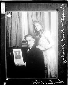 [Photograph of a portrait of Pearl Harding and her older brother Everett Harding together in a room holding a photograph of President Warren G. Harding 1921