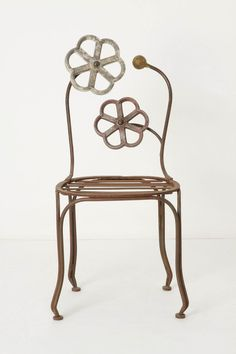 "Put a purple, grey or lime cushion on this ""Blacksmith Blossom Chair"" and enjoy whimsical French style. From Anthropologie. For more decor ideas visit http://www.landscapingnetwork.com/garden-styles/FrenchLandscapeDesign.pdf"