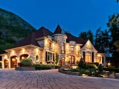 Does your dream home look anything like this? Love the lighting, greenery and brick walkway!