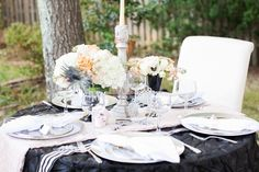Beautiful elegant Halloween wedding tablescape featuring our linens! Photo by Astrid Photography
