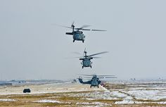 UH-60 Black Hawk helicopters from the 1st Air Cavalry Brigade, 1st Cavalry Division, depart from the flight line here, Feb. 13. The 1st Air Cavalry Brigade is currently in charge of U.S. aviation operations in Regional Command North and is providing aerial support for coalition ground forces.