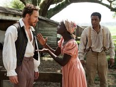 Michael Fassbender, Lupita Nyong'o and Chiwetel Ejiofor in 12 YEARS A SLAVE