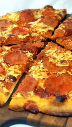 Your Basic Pepperoni Pizza - My Wife's Favorite Pizza and one of my 52 Pizza Party Pizzas! This is America's most ordered pizza.  Now all the recipes are in this post... Home made Dough, Sauce and easy to follow directions to get Pizzeria quality Pizza AT HOME!  Fantastic tasty DIY Project!
