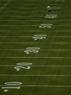 Field manager Allen Johnson paints the numbers on the field at Lambeau Field in Green Bay, Wis., on Thursday, Aug. 8, 2013. The Green Bay Packers host the Arizona Caridnals in a preseason NFL football game on Friday. (AP Photo/Green Bay Press-Gazette, Evan Siegle). #packers #nfl #vintage #lambeaufield