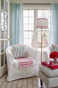 House of Turquoise: Lindsey Hene Interiors I like the ticking ottoman and the sky blue drapes, but not that odd color of red.