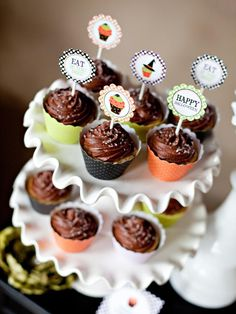 Pile It On in Throw a Halloween Cupcake-Decorating Party from HGTV