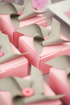 pink gift boxes and pinwheels as bows - sweet