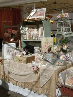 Gorgeous Display!  Layered tablecloths....  love the small blue bookcase for displaying items on the table.  And the old drawer!
