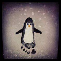 Footprint penguin.  Original idea from:  http://www.meetthedubiens.com/2010/12/footprint-penguins.html