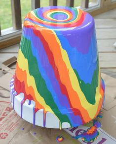 rainbow pour, painting flowers, pour paint, painted pots, painted flower pots, painted flowers, mothers day crafts, bright colors, kid