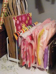 Great idea for storing gift bags and tissue paper using a kitchen baking sheets divider, from The Complete Guide to Imperfect Homemaking.  #organize #organise #craftroom