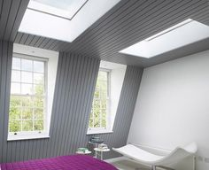 Roof lights in a mansard loft conversion. This bedroom loft space was well designed and thought out.