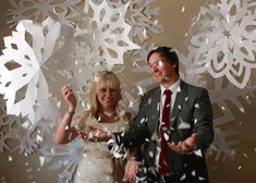 huge paper snowflakes as a backdrop. finally a use for the large format paper recycling bin scraps at work! :)
