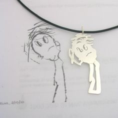 Child's drawing on jewelry. Oh I just LOVE this