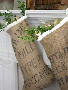 Coffee sack stockings with white ruffle trim. also love the greenery and ornaments coming out