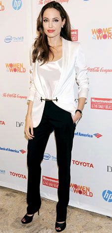 Angelina in InStyles Look of the Day, For the Women in the World Summit, Angelina Jolie suited up in a black and white Gucci ensemble and Pearl stud earrings.