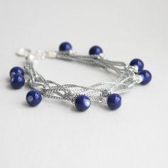 Royal Blue Hand Woven Bracelet Silver cord by CraftedLocally. #handmadejewelry #bracelet