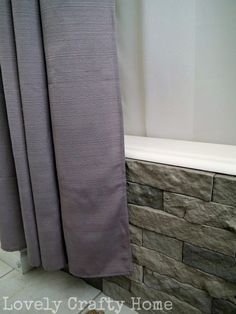 Airstone tub surround. These look really pretty and are much more affordable than stone.