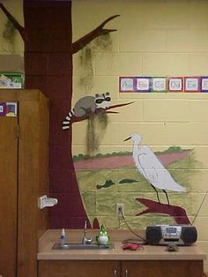 Swamp theme classroom mural by sink