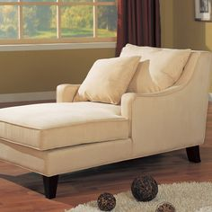 Microfiber-upholstered chaise lounge with tapered legs.   Product: Chaise loungeConstruction Material: Wood, fabric an...