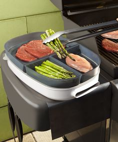 This multipurpose BBQ tray eliminates extra trips between the kitchen and grill. Containers with lids keep raw food safely separated while a serving platter and condiment caddy hold everything a grill chef needs at hand.