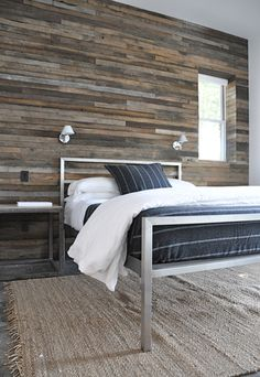 Back wall is so interesting.  Log cabin-like w modern bed.  Simple but not.