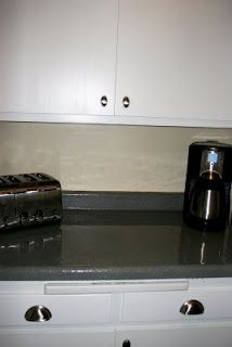 Paint a counter top...this was done on a laminate counter top