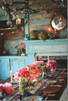 love the whole look, distressed blue wash on wood, old plank table, vine wrapped light.....