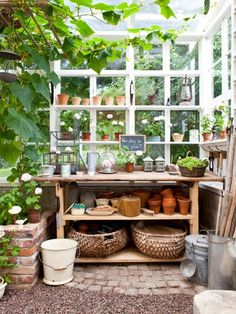 Shelves at window, brickwork, table with  storage, galvanized can with ladle scoop.