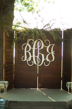 This country wedding bride created an altar backdrop out of vintage doors and then monogrammed them with the couple's initials!  Great idea.  country wedding.  southern wedding.  texas wedding.  rustic wedding.  vintage doors.  repurposed doors. vintage wedding.monogram wedding.