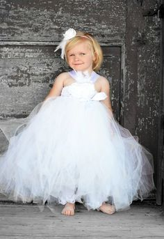 Gorgeous & elegant is this Snow white Tutu dress with silk rosette flowers & white feathers. This is perfect for your special wedding day .