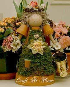 This cheerful angel craft is perfect for all seasons. Made out of clay pots, this crafty guardian angel will inspire you to get creative with your handmade gifts. terra cotta, diy crafts, flower pot, angel crafts, garden angels, clay flowers, clay pot crafts, pot garden, clay pots