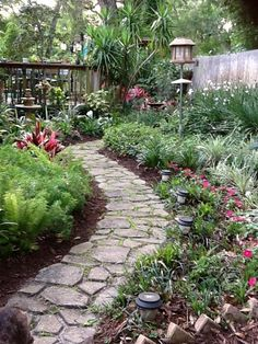 """Concrete Garden Path  """"We made this garden walkway with a mold that we purchased at Lowe's. We mixed the Quickcrete up and then poured it into the mold a section at a time. It was almost like making mud pies. It was a bit time consuming but we were very happy with the end result. It has held up very well as it has been down now for about 3 years."""""""