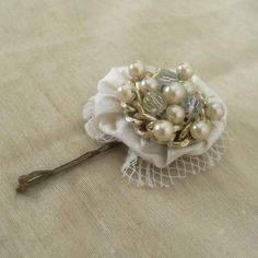 Vintage Upcycle:  A vintage beaded cluster ~ handmade hair accessory with a yo yo.  by Charlotte Self.