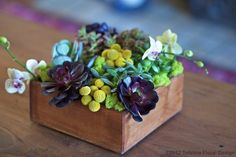 Succulent floral wedding centerpiece | Potted wedding centerpiece ideas | Green Bride Guide