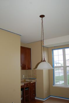 Quincy Tan HC-25 Benjamin Moore, and painted light fixture