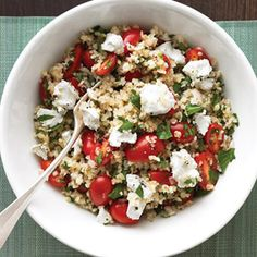 Enjoy this satisfying vegetarian main: a generous bulgur salad with crumbled goat cheese and juicy tomatoes.