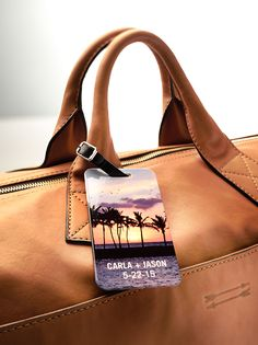 Custom luggage tags make the perfect favor for destination weddings. Personalize with a picture of your wedding venue, then add the guest's name.