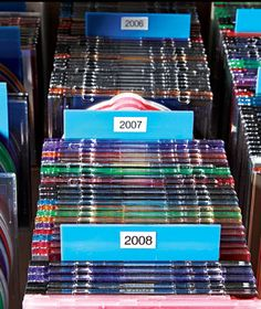 For digital images: Color-code your collection by storing discs in vibrant cases (slim jewel cases, $11.50 for 25, staples.com)―blue for parties, green for trips, and so on. Use empty cases positioned vertically and marked by the year as dividers; they'll extend about a half inch above the others.