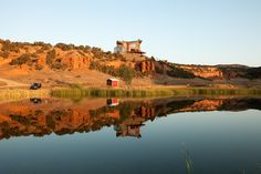 The main lodge at the Red Reflet (French for reflection) Ranch is an awe inspiring sight first thing in the morning. Photograph by Robert Wright