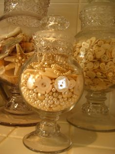 My collection of Old apothecary jars filled with pearls,seashells and shell buttons.