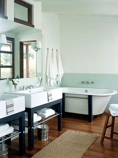 love everything about this bathroom. mirror opposite windows for amazing light, the bathtub, the sinks, the wood floor.