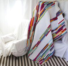 narrow multicoloured random pieced strips and white.
