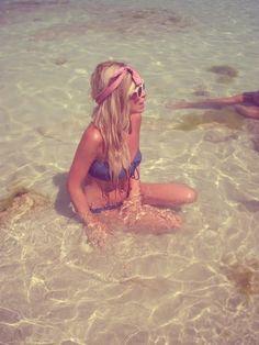 Enjoying the cool water / summer / sea / beach