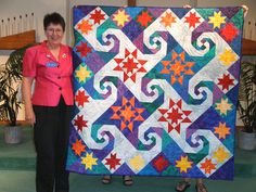 """Mountain Top Moments this is my presidents quilt made for me by the guild 2011.  the pattern is named """"Shakespeare in the Park"""" and block pattern has several names such as monkey wrench or snails trail or virginia reel."""