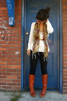 Fall fasion- dark solid skinny jeans with belted blouse top and cotton print scarf paired with simple classic brown leather boots.