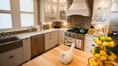 I want this kitchen!!!  This is the kitchen from Extreme Home Makeover in Savannah!  Love the style of cabinets and the brick backsplash!!!  It doesn't show it on this picture, but the island is antique turquiose wood!  <3