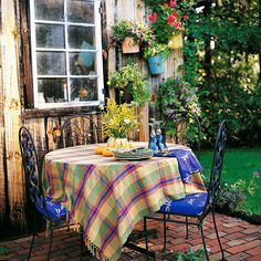 Create a colorful corner protected from breezes for a place to enjoy a morning cup of coffee or glass of orange juice. Your day will seem brighter when you begin it with a contemplative moment in the garden. Pretty and cheerful linens and chair cushions make the spot even more inviting.