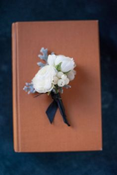 Classic white boutonniere. Wedding Floral Design: Mandy Scott Flowers Wedding Photographer: Sandra Fazzino Photography