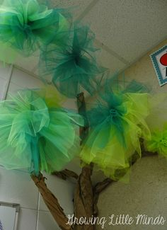 Use tulle and netting to make pom poms for a classroom tree.